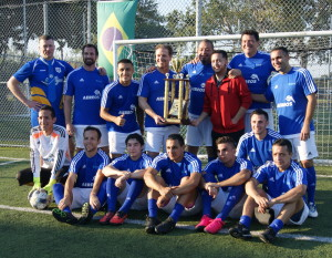 Atlas Aerospace soccer team with trophy