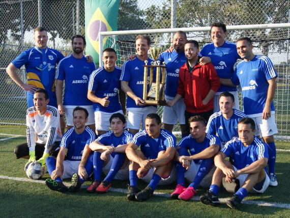 Atlas Aerospace soccer team with trophy